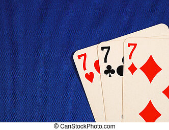 Lucky Sevens - Three of the number seven cards concepts of...
