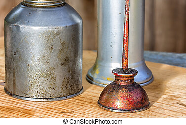 Three Oil Cans