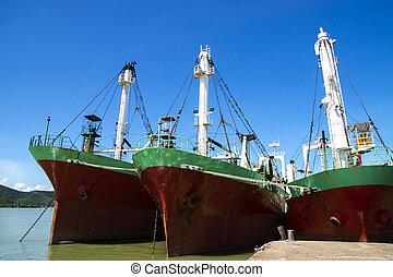 Three Old Cargo ship in harbor estuary. Thailand.
