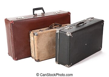 three old dirty dusty suitcase. focus on front corner of...