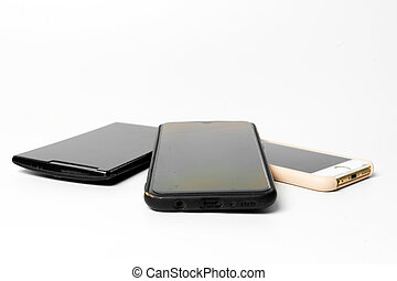 Three old mobile phones on a white background