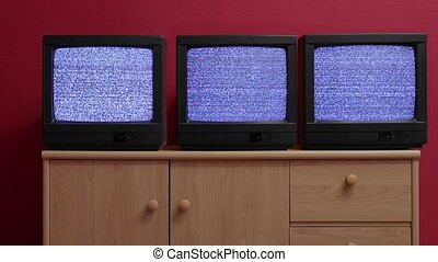 Three old TV sets