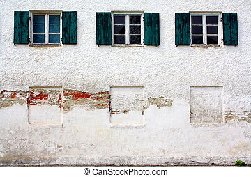 Three old windows on old white wall as background