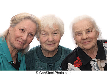 Three old women smiling, isolated on white background