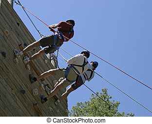 Three On Belay - Three climbers on belay after completing a ...