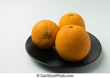 three orange on white background