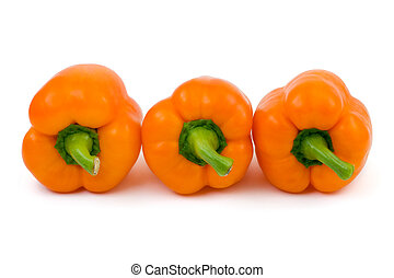 Three orange peppers isolated on white background