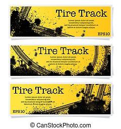 Three orange tire track banners