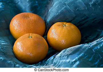 Three Oranges Awash in Blue - Photograph of three oranges...