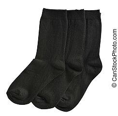 Three Pair of black male socks on white background
