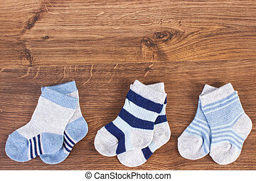 Three pair of socks for newborn, expecting for kids concept, place for text
