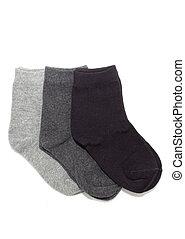 Three pairs of grey socks, isolated on white