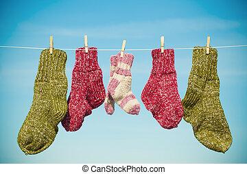 Three pairs of woolen socks