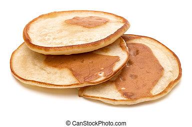 Three pancakes isolated on white background cutout.