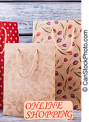 Three paper shopping bags.