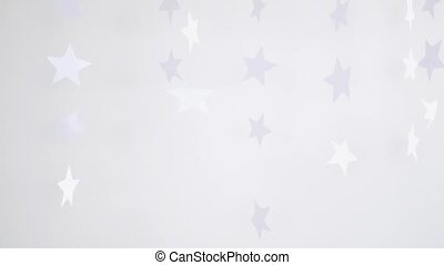 Three paper snowflakes hanging and rotating decoration on a white background. slow motion. Christmas concept. 3840x2160