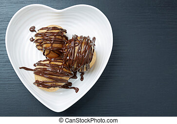 Three Pastries with Chocolate Sauce on a Plate