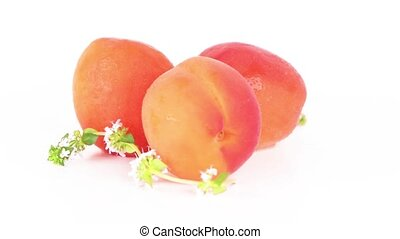 Three peaches close-up isolated on white background.
