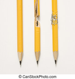 Three pencils. - Whole pencil, broken pencil and stapled...