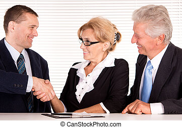 three people at office - portrait of a good team work at...
