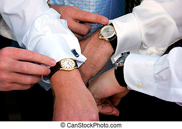 Three people checking the time on their watches.