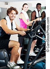 Three people doing cardio training
