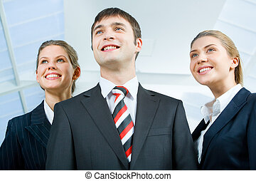 Three people - Image of three business people in suits and...