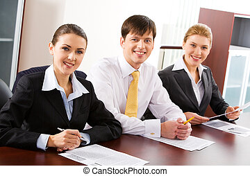 Three people - Image of three business people sitting at the...