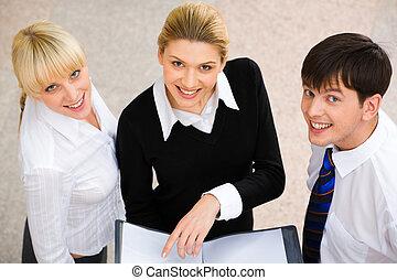 Three people - Image of three smiling business people...