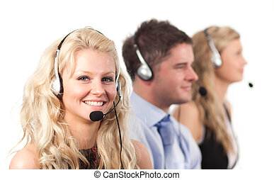 Three people in a call centre - Three working in in a call...