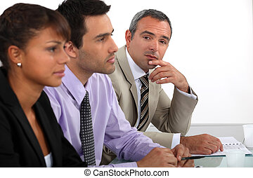 Three people on interview panel
