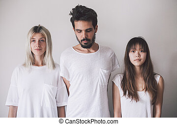 three people standing on white background
