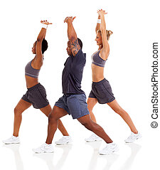 three people stretching before exercising