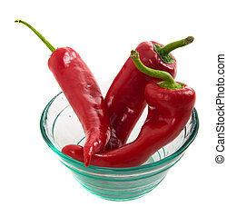 three peppers in a glass bowl
