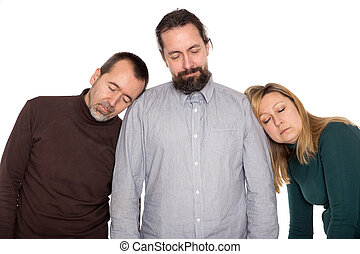 three persons sleeping standing up