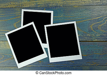 three photo frame on old wooden background