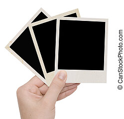 three photo frames in a hand