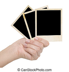 three photo frames in a hand