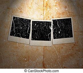 three photo frames on grunge background