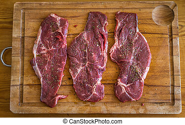 Three pieces of raw meat