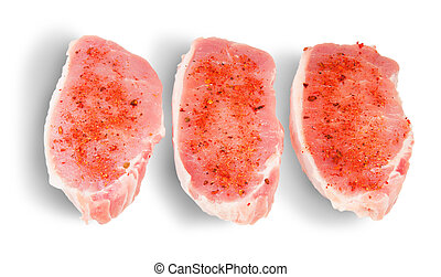 Three Pieces Of Raw Pork With Spices