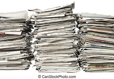 Three piles of newspapers