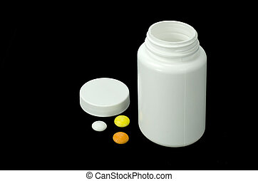 three pills with white jar - three pills of a different...