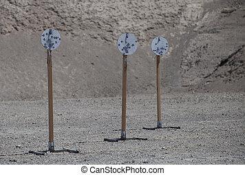 Three pistol targets at the range