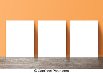 three placard standing next to a yellow wall