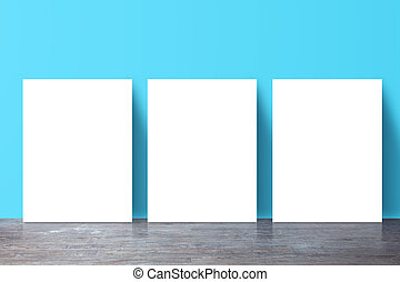 three  placard standing next to a blue wall