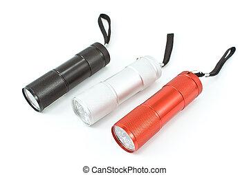 Three pocket flashlight torch isolated on white