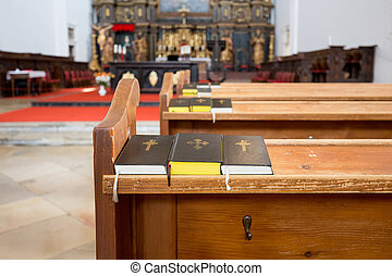 Three prayer books on a bench