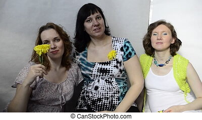 Three pregnant woman with yellow