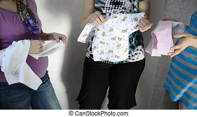 Three pregnant women, clothes